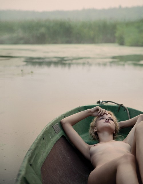Nude lying in a row boat