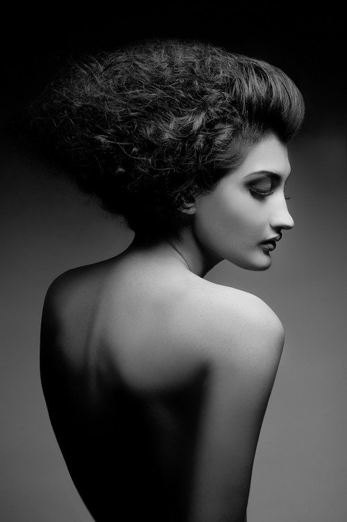 black & white profile picture of a nude woman taken from the back