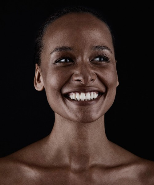 colour portrait of a smiling woman with dark brown skin