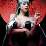 photograph of a woman cosplaying as Morrigan from the video game Darkstalkers