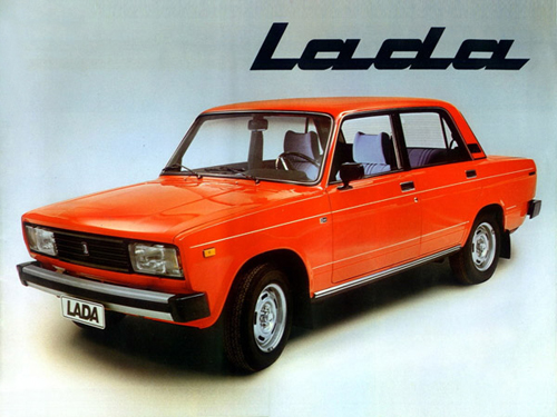 photograph of a classic orange lada car