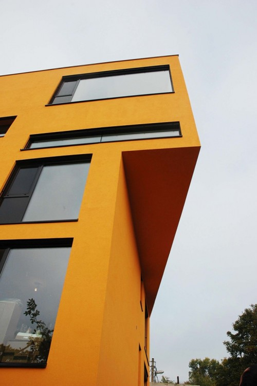 picture of the corner of an avant garde yellow building