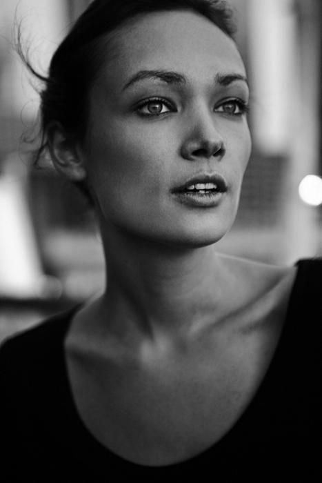 black & white portrait of a woman wearing a black top
