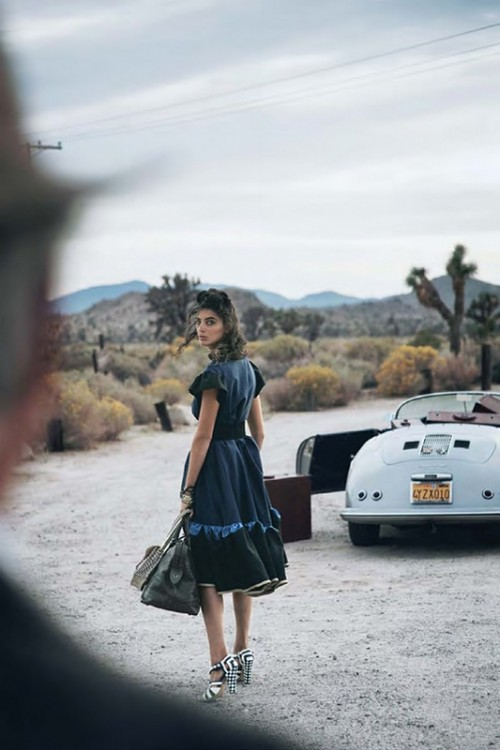 fashion shoot photo of woman looking back as she heads towards a car