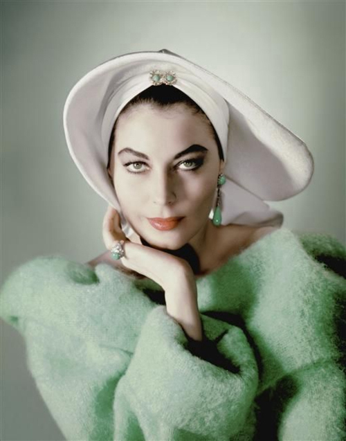 photograph of ava gardner in a white hat and green coat