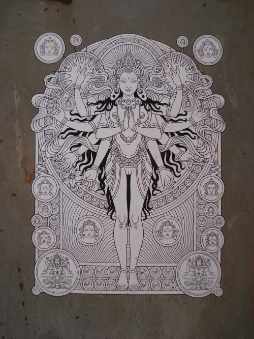 black & white illustration of a many armed goddess