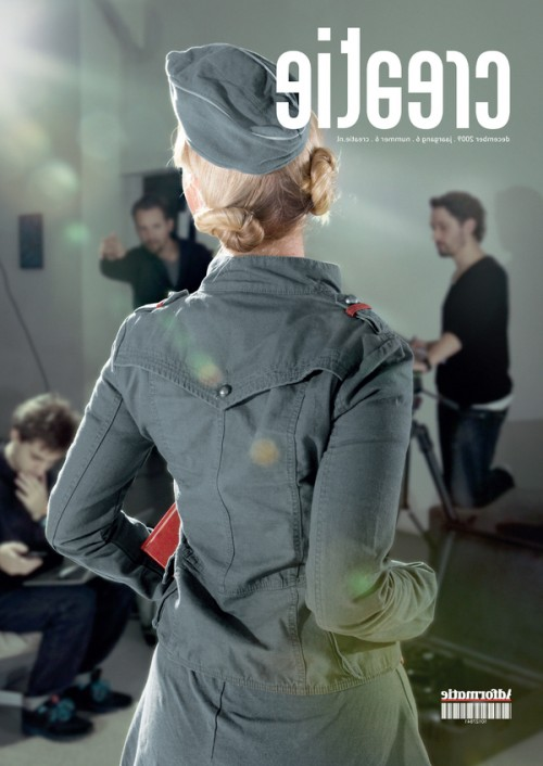 photograph of a magazine cover featuring the back of a model