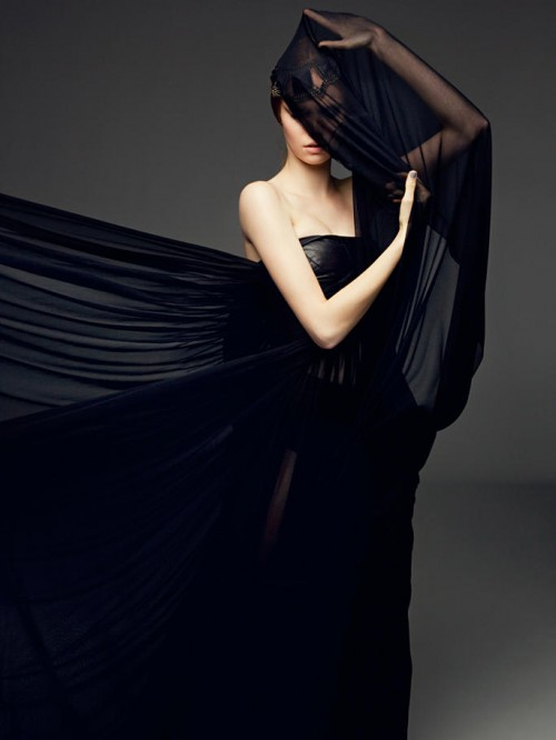 picture of a woman in flowing black dress with face obscured