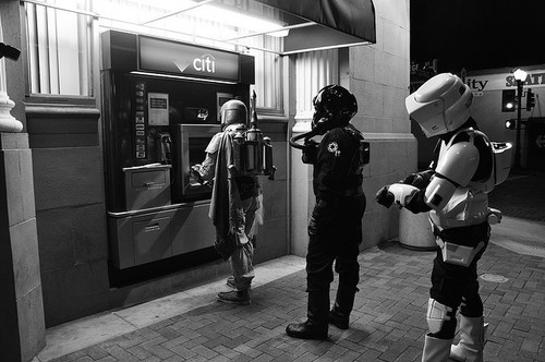 black & white photo of boba fett, imperial pilot and speeder pilot at ATM