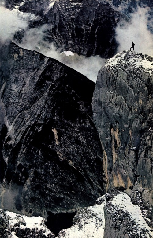photograph of a man on dark mountain