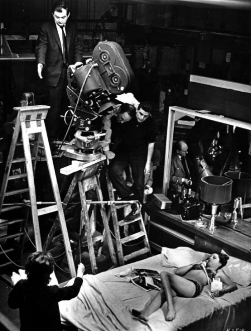 black & white on-set picture of stanley kubrick shooting a scene
