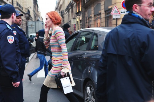 photo of a woman with red hair crossing a street
