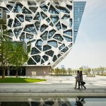 two women walking through courtyard of alibaba group headquarters in hangzhou china