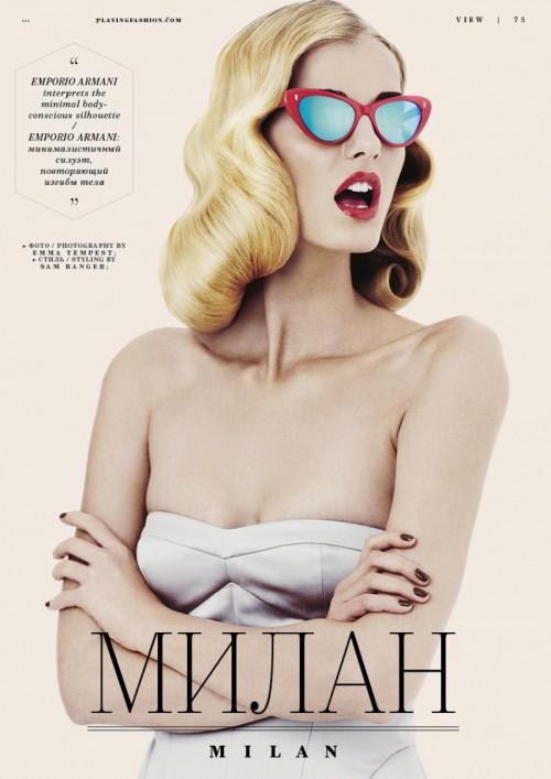 woman in white bikini top with sunglasses