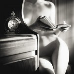 nude woman reading a book