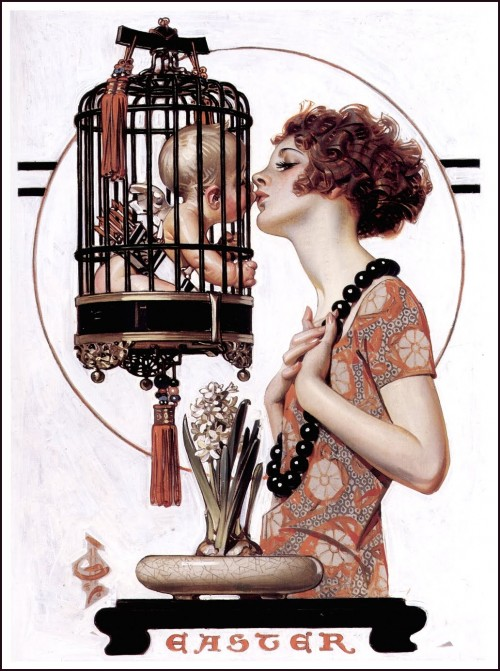 woman kissing a caged cherub