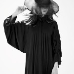 Photo of a robed girl in hat by Marcus Pritzi