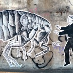 graffiti by sr. x of blindfolden man and giant bug