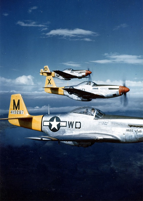 three planes flying in formation