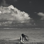 nude crouching near beach