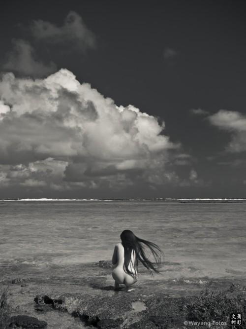 nude crouching near beach