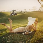 barefoot woman lounging on golf course
