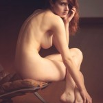 nude model on leather chair