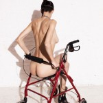 nude woman in high heels sitting on walker-chair