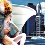 model sitting on yacht with hair on fire