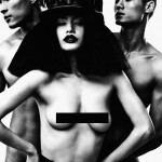 woman in hat with black bar over breasts, nude men behind her