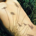 The shadows of flowers on Rosie Huntington-Whiteley&#039;s nude back