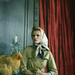 Edita Vilkeviciute poses in country clothing with a chicken in Vogue Nippon