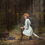 redhead woman in white dress in forest set