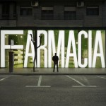facade of refurbished pharmacy in spain with giant illuminated type