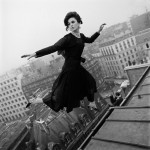 woman flying over cityscape in 1965