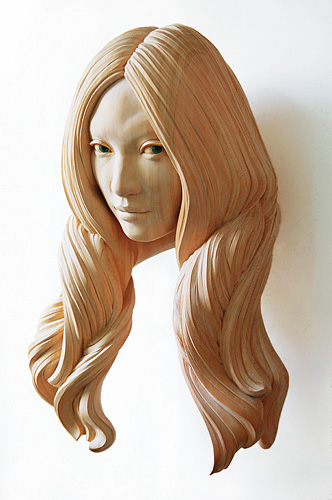Cypress wood sculpture of a woman's head with detailed hair by Yasuhiro Sakurai