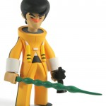 bruce lee-esque figure with green sword