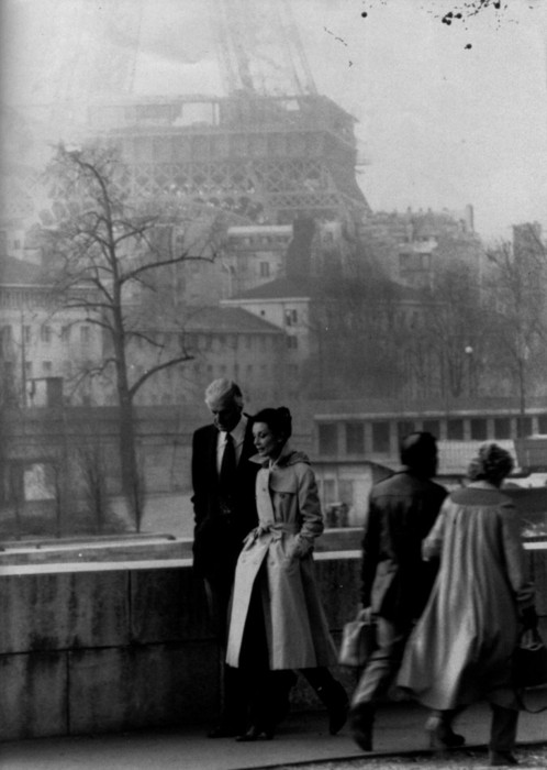 Hubert de Givenchy and Audrey Hepburn walking in Paris with Eiffel Tower in background