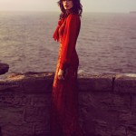 woman in red lace dress by the sea