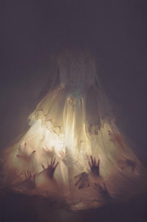 hands seen through illuminated lace dress