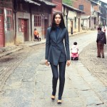 woman in suit walks in chinese street