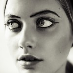 woman with heavy eye makeup close-up portrait