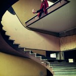 woman at top of spiral staircase