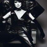 Keira Knightley smoking a cigarette sitting on a couch wearing leather
