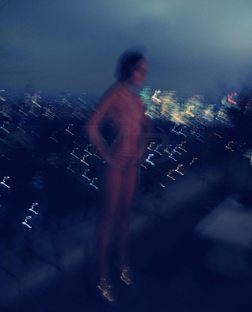 long exposure with light streaks, of nude woman and cityscape