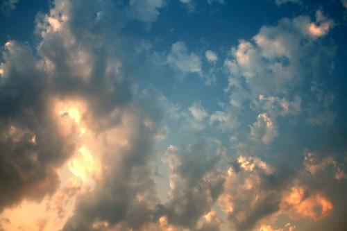 Golden clouds on blue sky