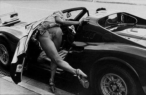 Girl bending over a Ferrari