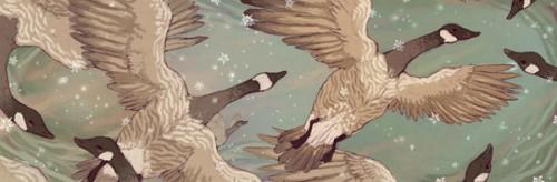 Geese flying in falling snow
