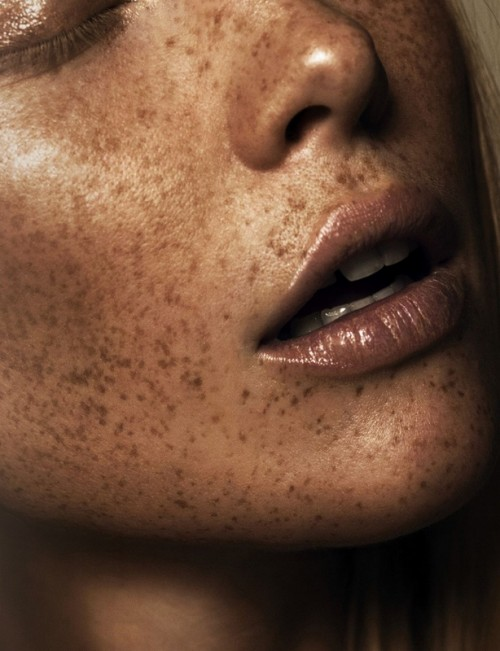 ultra close-up portrait of the lower half of a freckled woman's face