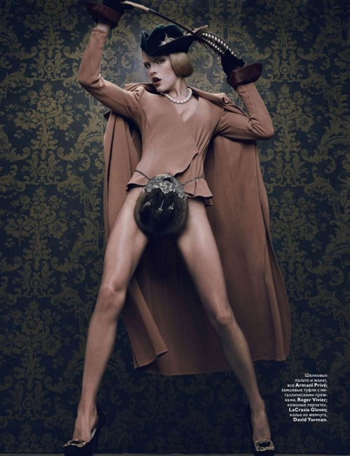 fashion photo of a model wearing a cape and a codpiece